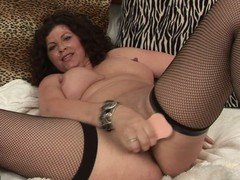 Lewd housewife getting wet on a sex-toy