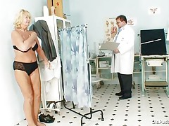 golden-haired mature getting ready to examine her body