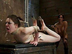 busty brunette fucking a tied chick hard