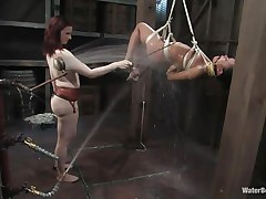 oriental bitch tied, hanged and showered before next stage