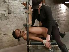 dark vibrator on a tied dark bitch