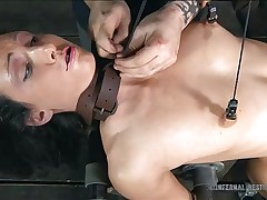 getting her pussy wet in a sadomasochism session