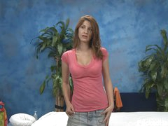 Delicate brown haired girl Karina in pink t-shirt and blue jean mini skirt does some modelling in the massage room with her clothes on before massage. Do u like her cute face and hot legs?