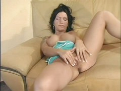 Raven haired busty Sabrina Dotee spreads her legs and strokes her shaved pussy like crazy in this solo scene. This babe can't stop rubbing her in nature's garb snatch. Sabrina Dotee puts her hands on her fake mambos from time to time.